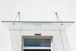 Vordach aus Glas - Glasvordach mit Edelstahlbefestigung